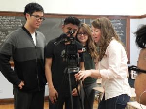 Elise Haas, a Loyola Journalism student helps Senn students frame a shot