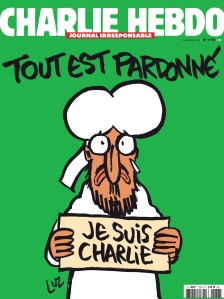 The cover of Charlie Hebdo after the terror attacks. Mohammed holds a sign reading