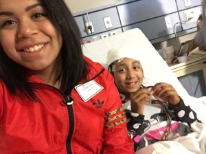 Author Kathy Tobar poses for a selfie with her sister, Emily Garcia at Rush University Hospital during an EEG test (photo: Kathy Tobar)