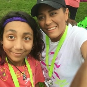 """Sara Garcia (Right) poses with her daughter Emily in Grant Park for a """"Girls on the Run"""" marathon"""